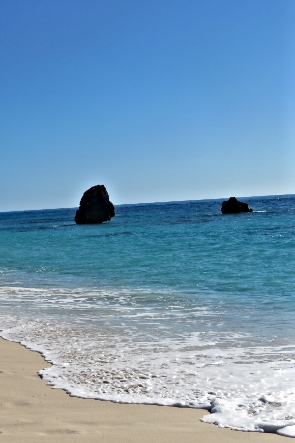 Large rocks off the beautiful beaches of Bermuda #travel #Bermuda #beach #beaches